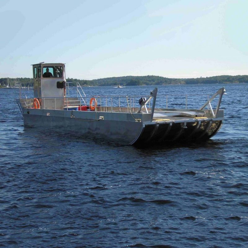 Custom Built Barge for vehicle ferrying, marine cable service, heavy equipment, and materials transport.